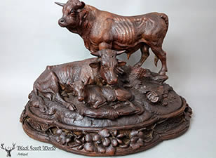 black forest carved cow family